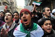 Syrians chant slogans during a demonstration after Friday prayer in the northeastern city of Aleppo on February 15, 2013
