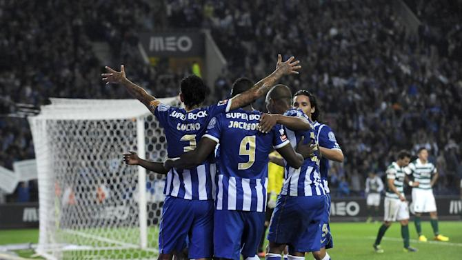 FC Porto's Lucho Gonzalez, left, from Argentina celebrates with teammates after scoring his side's third goal against Sporting in a Portuguese League soccer match at the Dragao stadium in Porto, Portugal, Sunday, Oct. 27, 2013. Lucho scored once in Porto's 3-1 victory and the club stands top of the league