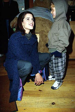 """Neve Campbell, star of the upcoming """"Panic"""" and """"Drowning Mona,"""" with little David Dorfman Sundance Film Festival January 22, 2000 Jeff Vespa, Wireimage.com - Photo"""