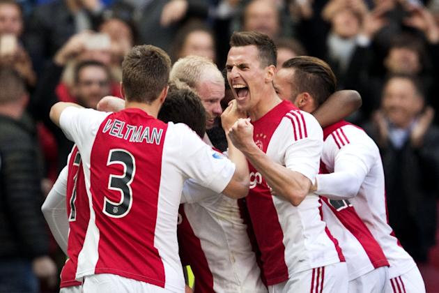 Ajax Amsterdam players celebrate after scoring a goal during the Dutch first league football match against FC Twente in Amsterdam, on May 1, 2016