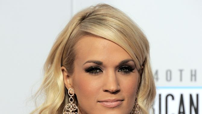 """FILE - In this Sunday, Nov. 18, 2012 file photo, Carrie Underwood arrives at the 40th Anniversary American Music Awards in Los Angeles. Underwood will star in NBC's live broadcast of """"The Sound of Music"""" late next year, according to a news release Friday, Nov. 30, 2012. (Photo by Jordan Strauss/Invision/AP, File)"""