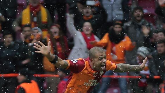 Galatasaray's Felipe Melo, above, celebrates with teammates after their Champions League soccer match victory over Juventus at the TT Arena Stadium in Istanbul, Turkey, Wednesday, Dec. 11, 2013. The match was halted Tuesday in the 31st minute with the score at 0-0 as hail and snow began to fall heavily in Istanbul, but resumed Wednesday. (AP Photo)