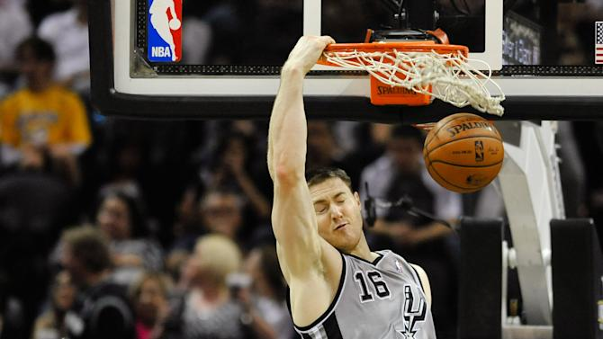 San Antonio Spurs center Aron Baynes dunks in front of Los Angeles Lakers' Pau Gasol and Kendall Marshall in the first half of an NBA basketball game Friday, March 14, 2014 in San Antonio. The Spurs won 119-85