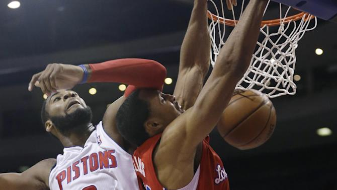 Los Angeles Clippers center Ryan Hollins, right, dunks while defended by Detroit Pistons center Andre Drummond (0) during the second half of an NBA basketball game in Auburn Hills, Mich., Monday, Jan. 20, 2014