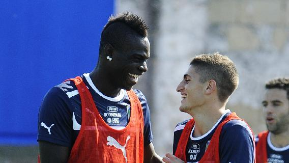 Italy's Mario Balotelli sheres a light moment with Alessandro Florenzi, right, during a training session with their team at the Giarrusso stadium in the outskirts of Naples, Monday, Oct. 14, 2013, ahead of a 2014 FIFA World Cup, Group B, qualification match against Armenia in Naples on Tuesday.  Other teams in Group B are, Denmark, Bulgaria, Czech Republic, and Malta