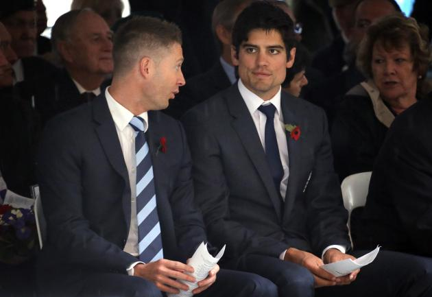 Captain of the England cricket team Cook and his Australian counterpart Clarke talk before the start of a Remembrance Day ceremony in Sydney