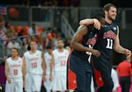 US forward Kevin Love (R) and US gard James Harden celebrate at the end of the Men's preliminary round group A basketball match of the London 2012 Olympic Games Tunisia vs USA at the basketball arena in London. USA won 110 to 63