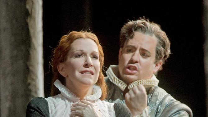 """In this Dec. 24, 2012 photo provided by the Metropolitan Opera, Joyce DiDonato plays Maria Stuarda and Matthew Polenzani is Leicester during a dress rehearsal of Donizetti's """"Maria Stuarda,"""" at the Metropolitan Opera in New York. (AP Photo/Metropolitan Opera, Ken Howard)"""