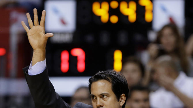 Miami Heat head coach Erik Spoelstra gestures during the first half of the Heat's NBA basketball game against the Golden State Warriors, Thursday, Jan. 2, 2014, in Miami. (AP Photo/Lynne Sladky)