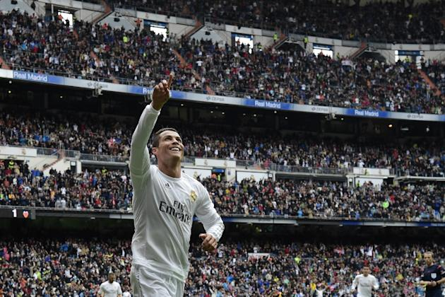 Real Madrid's forward Cristiano Ronaldo celebrates after scoring a goal during the Spanish league football match Real Madrid CF vs Valencia CF at the Santiago Bernabeu stadium in Madrid on May 8,