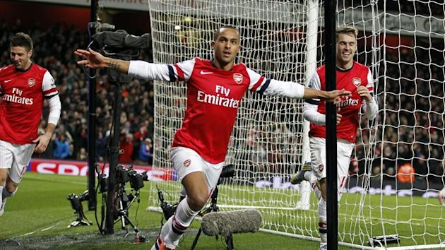Theo Walcott celebrates his goal for Arsenal against Liverpool (AFP)