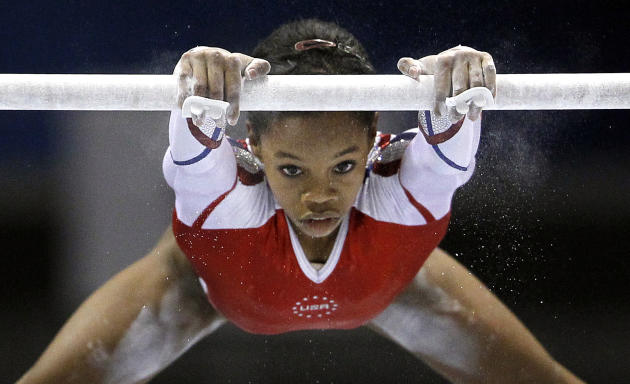 USA's Gabrielle Douglas performs on the uneven bars during the women's team final at  the Artistic Gymnastics World Championships in Tokyo, Japan, Tuesday, Oct. 11, 2011. (AP Photo/Bullit Marquez)