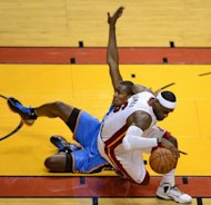 "LeBron James (R) of the Miami Heat collides with Serge Ibaka (L) of the Oklahoma City Thunder during Game 3 of the NBA Finals on June 17. James fired back at Ibaka, calling him ""stupid"" after the Oklahoma City forward said people were giving James too much credit in the NBA finals for his defensive play"