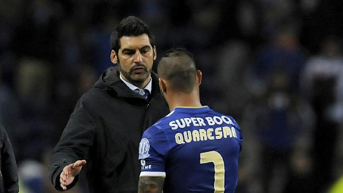 FC Porto's coach Paulo Fonseca greets Ricardo Quaresma, right, after their 1-0 defeat with Estoril in a Portuguese League soccer match at the Dragao stadium, in Porto, Portugal, Sunday, Feb. 23, 2014