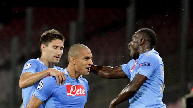 Napoli's Gokhan Inler, center, celebrates after scoring during a Champions League, group F, soccer match between Napoli and Marseille, at the Naples San Paolo stadium, Italy, Wednesday, Nov. 6, 2013