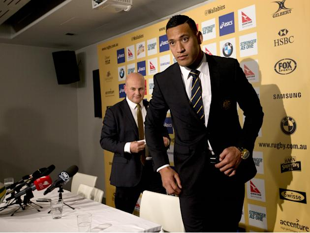 Australian Wallabies Rugby team fullback Israel Folau leaves a news conference with Australian Rugby Union general manager Rob Clarke at the Wallabies Headquarters in Sydney