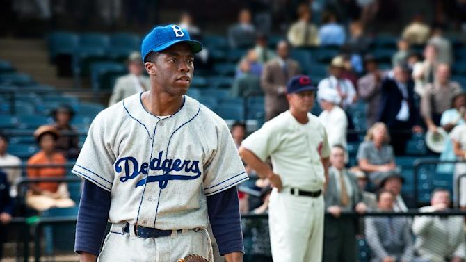 """This film image released by Warner Bros. Pictures shows Chadwick Boseman as Jackie Robinson in a scene from """"42.""""  (AP Photo/Warner Bros. Pictures, D. Stevens)"""