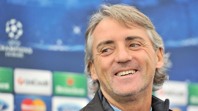 Roberto Mancini admits Manchester City must tighten up at the back