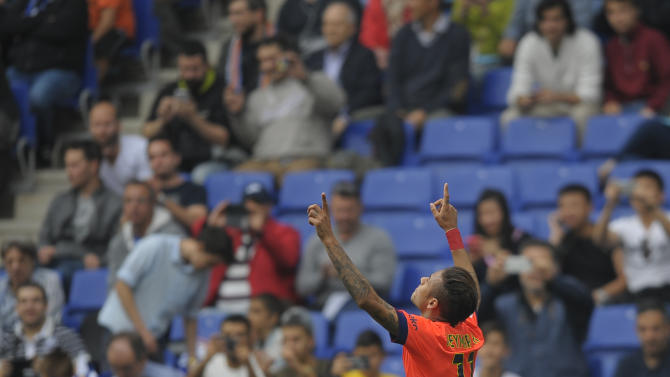 FC Barcelona's Neymar, from Brazil, reacts after scoring against Espanyol during a Spanish La Liga soccer match at Cornella-El Prat stadium in Cornella Llobregat, Spain, Saturday, April 25, 2015. (AP Photo/Manu Fernandez)