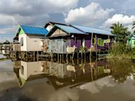 House on stilts: Some of the houses had lost their footing and were slowly merging with the canals, looking like old men slowly crouching for a hot spring bath. (