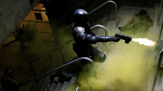 """This film image released by Lionsgate shows Karl Urban in a scene from """"Dredd 3D."""" (AP Photo/Lionsgate)"""