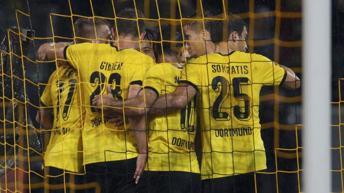 Borussia Dortmund players celebrate a goal against Odd Grenland BK during their Europa League play-off soccer match in Dortmund