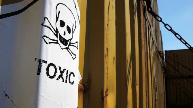 "In this photo taken on Tuesday, May 13, 2014, a sticker reading ""Toxic"" on containers carrying Syria's dangerous chemical weapons, on the Danish cargo ship, Ark Futura, transporting the chemical weapons out of the strife-torn country, in Cyprus coastal waters. Organization for the Prohibition of Chemical Weapons director general Ahmet Uzumcu said Monday, June 23, 2014, the final shipment of stockpiled chemical weapons has been loaded onto Danish and Norwegian ships for transportation out of Syria.(AP Photo/Petros Karadjias)"