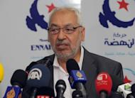 Tunisian Ennahda Islamist party's leader, Rached Ghannouchi speaks during a press conference on May 15, 2013 in Tunis. The head of Tunisia's ruling Islamist party Ennahda is to meet the powerful UGTT trade union chief on Monday on the crisis sparked by the killing of an opposition politician