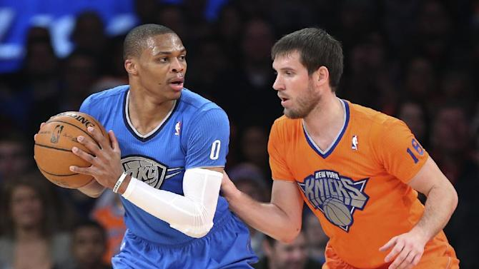 Oklahoma City Thunder point guard Russell Westbrook (0) looks to pass around New York Knicks point guard Beno Udrih (18) during the first half of an NBA basketball game at Madison Square Garden, Wednesday, Dec. 25, 2013, in New York. The Thunder won 123-94