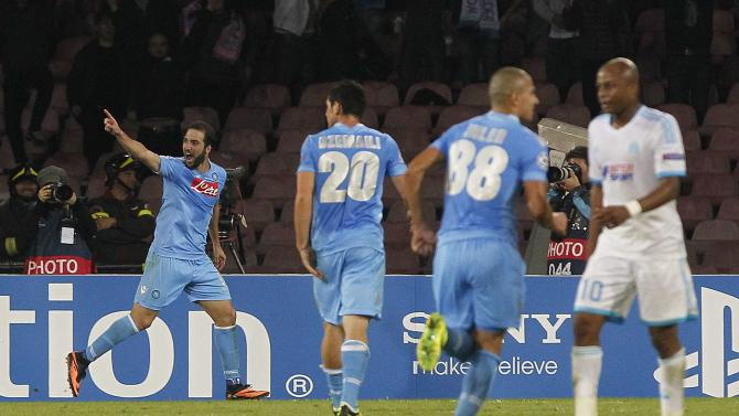 Napoli's Higuain celebrates after scoring against Olympique Marseille during their Champions League soccer match at San Paolo stadium in Naples