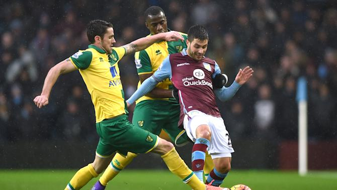 Aston Villa's Carles Gil with Norwich's Robbie Brady and Sebastian Bassong