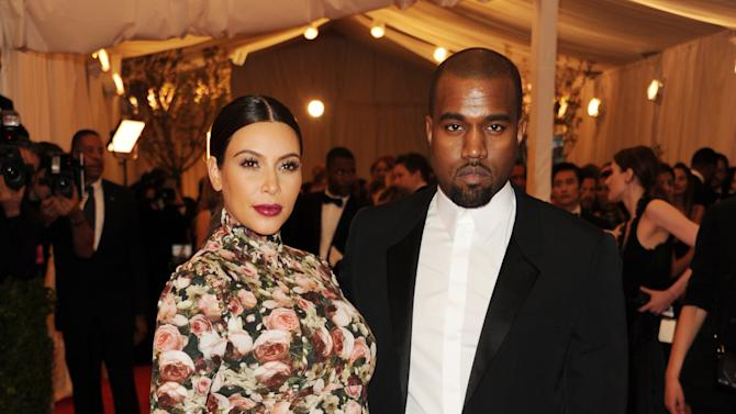 "Kim Kardashian and Kanye West attend The Metropolitan Museum of Art's Costume Institute benefit celebrating ""PUNK: Chaos to Couture"" on Monday, May 6, 2013, in New York. (Photo by Evan Agostini/Invision/AP)"