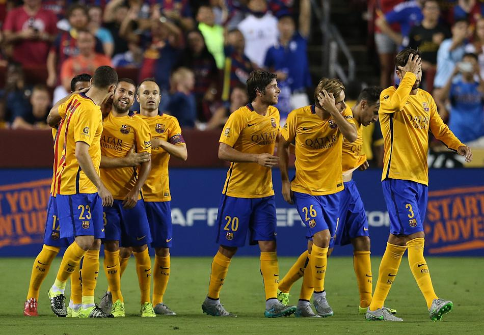 FC Barcelona celebrates on Tuesday,July,28, 2015, in Landover, Maryland. Chelsea and FC Barcelona face off at the 2015 International Champions Cup. Damian Strohmeyer/AP Images for International Champi