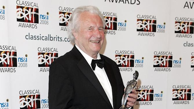 FILE - In this May 8, 2008 file photo British conductor Sir Colin Davis, president of the London Symphony Orchestra, holds a Classical BRIT award.  The London Symphony Orchestra says its president and principal conductor, Colin Davis, has died aged 85. One of the best-known figures in British classical music, Davis worked with the symphony for more than half a century. (AP Photo/`PA, Matt Crossick, File) UNITED KINGDOM OUT