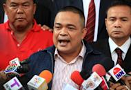 "Thai ""Red Shirt"" leader Jatuporn Prompan speaks to reporters as he leaves a courthouse in Bangkok, on December 14, 2012. Prompan has been cleared of slander over claims that he accused the former premier of sitting incorrectly during an audience with the king"