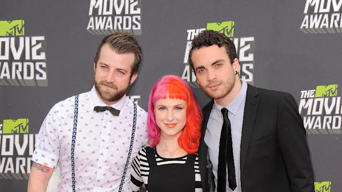 Jeremy Davis, Hayley Williams and Taylor York of Paramore arrive at the MTV Movie Awards in Sony Pictures Studio Lot in Culver City, Calif., on Sunday April 14, 2013. (Photo by Jordan Strauss/Invision/AP)