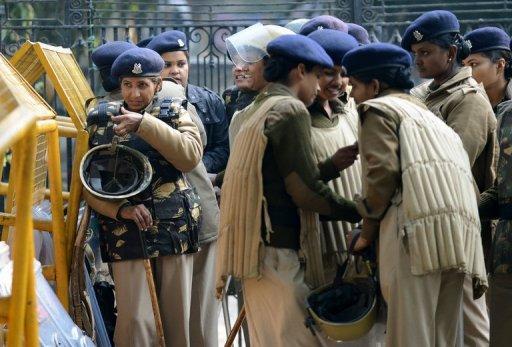 Police gather on a street in New Delhi, on December 29, 2012, as Indian leaders appealled for calm fearing fresh outbursts of protests after the death of a gang-rape victim. Police threw a ring of steel around the centre of the capital after news of the 23-year-old's death was broken in the early hours of the morning by the Singapore hospital that had been treating her for the last 2 days.