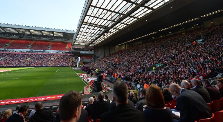 Thousands of people attend a memorial service to mark the 25th anniversary of the Hillsborough Disaster at Anfield Stadium in Liverpool, northwest England on April 15, 2014