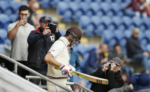 Cricket: Surrey's Kevin Pietersen walks out to bat