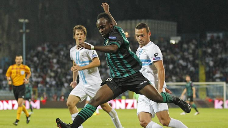 Betis' Cedric, center, is challenged by Rijeka's Ivan Mocinic, left and Ivan Tomecak during their group I Europa League first round second leg soccer match, at Kantrida stadium in Rijeka, Croatia, Thursday, Oct. 3, 2013