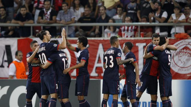 Paris St Germain's players celebrate after scoring against Olympiakos during their Champions League soccer match at Karaiskaki stadium in Piraeus