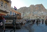 Syrian pro-government troops are seen on the streets of the Christian town of Maalula on September 11, 2013