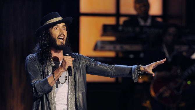 "Comedian Russell Brand performs at ""Eddie Murphy: One Night Only,"" a celebration of Murphy's career at the Saban Theater on Saturday, Nov. 3, 2012, in Beverly Hills, Calif. (Photo by Chris Pizzello/Invision)"