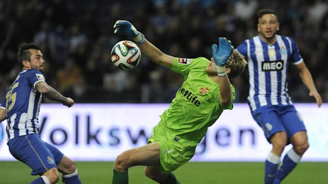 FC Porto's Steven Defour, left, from Belgium and Nabil Ghilas, from Algeria, right,  fail to score past Belenenses' goalkeeper Matt Jones, from England, in a Portuguese League soccer match at the Dragao stadium in Porto, Portugal, Sunday, March 23, 2014