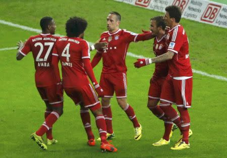 Bayern Munich's Ribery celebrates with his team mates after scoring against Hertha Berlin during their German first division Bundesliga soccer match in Berlin