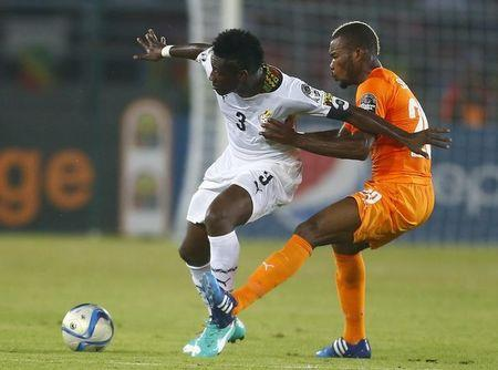 Ivory Coast's Serey Die challenges Ghana's Asamoah Gyan during the African Nations Cup final soccer match in Bata