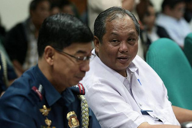 File photo: DILG undersecretary Rico Puno (right) and Philippine National Police Director General Nicanor Bartolome are seen during the Senate Committee on Finance performance review of the Department of Interior and Local Government (DILG) held at the Senate in Pasay City, south of Manila, on 31 July 2012. (Voltaire Domingo, NPPA Images)