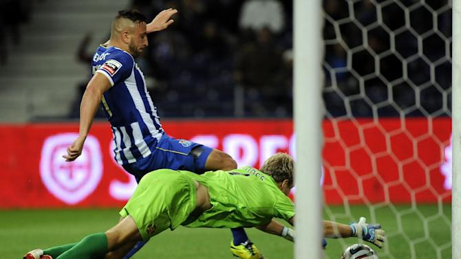 FC Porto's Nabil Ghilas, from Algeria, fails to score past Belenenses' goalkeeper Matt Jones, from England, in a Portuguese League soccer match at the Dragao stadium in Porto, Portugal, Sunday, March 23, 2014. Porto won 1-0