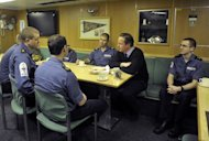 Prime Minister David Cameron speaks with Navy personnel during a visit to the Trident Nuclear Submarine, HMS Victorious, on April 4, 2013. Britain holds a long-standing belief in continuous at-sea deterrence, which requires the running of at least one Vanguard submarine armed with 16 Trident nuclear missiles at any given time