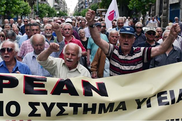 Pensioners march towards the Ministry of Health in Athens during a 24-hour strike by health workers and doctors on May 20, 2015